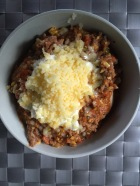 Roasted spud topped with savoury mince, cheese and sour cream all GF